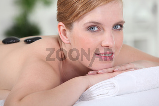 young woman relaxing on the massage table