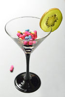 cocktailglass with pills and fruit