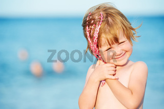 little girl at sunset in front of red sea