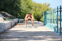 Man squatting outdoors
