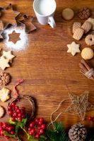 Composition of christmas decorations with mug, christmas cookies and copy space on wooden background