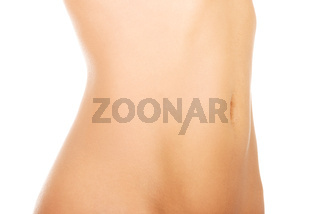 Close up of perfect nude body of young fit woman