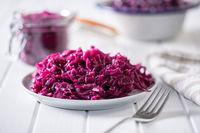 Red sauerkraut. Sour pickled cabbage on plate.