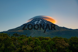 Lenticular clouds with the light of sunrise above Mount Taranaki in New Plymouth, New Zealand