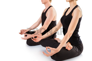 Meditating in the lotus position close up