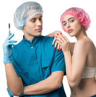 Plastic surgeon with his female beautiful patient