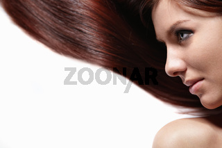 Beautiful girl with shiny hair on a white background