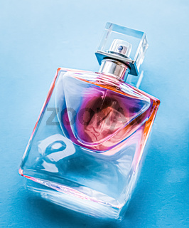 Perfume bottle on glossy background, sweet floral scent, glamour fragrance and eau de parfum as holiday gift and luxury beauty cosmetics brand design