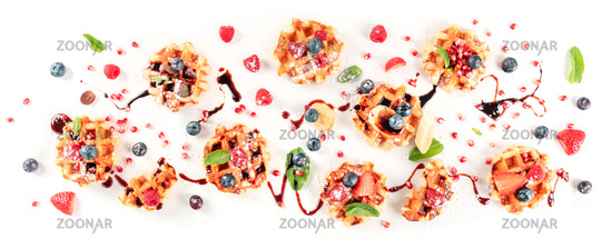 Belgian waffles with fresh fruit, chocolate, and mint, overhead flat lay shot