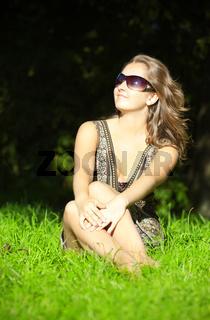 beautiful girl sitting in grass