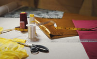 Close up of dressmaker workplace table with sewing set