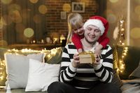 Merry Christmas and Happy New Year. Christmas gift surprise. Father and daughter
