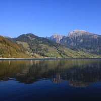Mountain landscape reflecting in Lake Waegital.