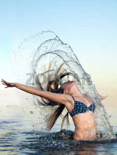 blonde woman on water bckground