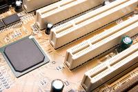 black empty processor on orange motherboard