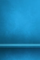 Empty shelf on a blue wall. Background template. Vertical backdrop