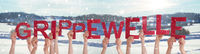 People Hands Holding Word Grippewelle Means Flu Epidemic, Winter Background