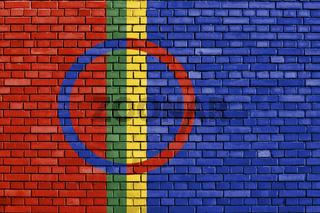 flag of Sami people painted on brick wall