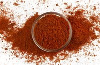 Paprika powder isolated on white background, top view