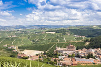 Panoramic countryside in Piedmont region, Italy. Scenic vineyard hill with the famous Barolo Castle.