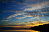 View of the picturesque sunset on Lake Pongoma, North Karelia, Russia