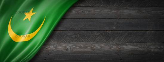 Mauritania flag on black wood wall banner