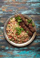 Arab Turkish kebab with tabbouleh salad