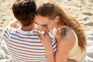 happy couple chilling on summer beach