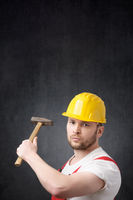 Portrait of a construction worker with hammer