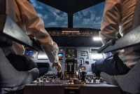 pilots in a cockpit in an airplane