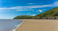 View of LLansteffan beach in southern Wales surrounded by sand and small hills