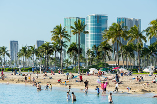 Tourists on busy beach of Waikiki