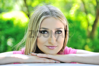 Closeup image of a beautiful blonde girl in nature
