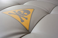 Upholstery close up with poison symbol.