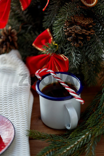 cup of coffee with candy cane at home on christmas