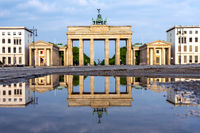 The famous Brandenburger Tor in Berlin reflected in a puddle