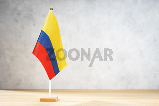 Colombia table flag on white textured wall. Copy space for text, designs or drawings