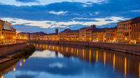 City of Pisa and Arno river at dusk