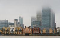 Skyline of Canary Wharf business centre at mist. London united kingdom