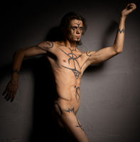 Young handsome male with bodyart in the nude
