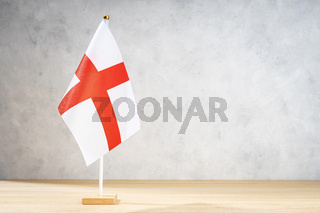 Alessandria table flag on white textured wall. Copy space for text, designs or drawings
