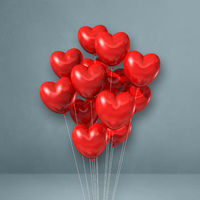 Red heart shape balloons bunch on a grey wall background
