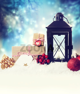 Christmas lantern with ornaments in the snow
