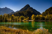 A view of Lake Jasna with forest and mountain landscape in beautiful autumn colors