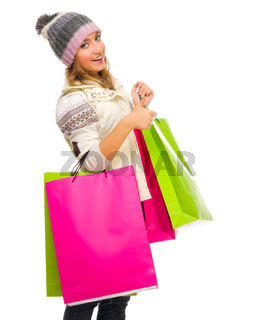 Young girl with bags shows ok gesture isolated