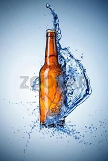 Beer bottle with water splash