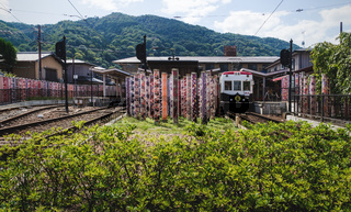 Arashiyama Station with Kimono forest of about 600 poles decorated with kimono fabrics in Kyoto, Japan