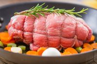 Raw Beef Roast in a Pan . High quality photo.