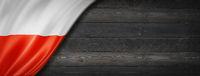 Polish flag on black wood wall banner