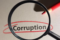 Corruption text circled in red pencil with magnifying glass